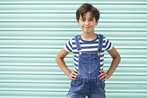 Portrait of smiling little girl wearing dungarees - JSMF00418
