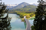 Mountain landscape with forests and bridge crossing dam in the foreground. - MINF06545