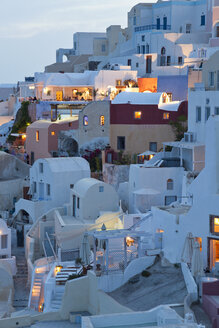 High angle view of traditional white washed houses on a Greek Island at dusk. - MINF06575