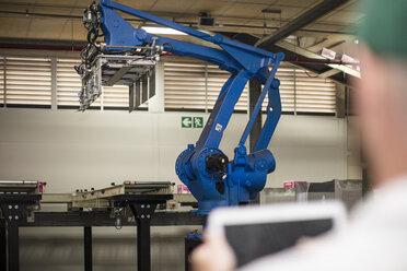 Worker using tablet in factory - ZEF15954