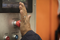 Worker using control panel, emergency button - ZEF15963