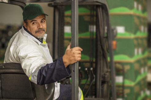 Worker sitting in forklift - ZEF15966