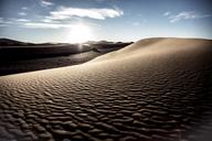 Desert landscape with sand dunes under a cloudy sky. - MINF06633