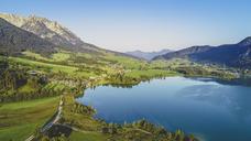 Austria, Tyrol, Kaiserwinkl, Aerial view of lake Walchsee - AIF00538