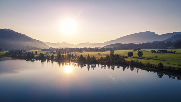 Austria, Tyrol, Kaiserwinkl, Aerial view of lake Walchsee at sunrise - AIF00541