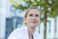 Portrait of smiling blond businesswoman - TCF05546
