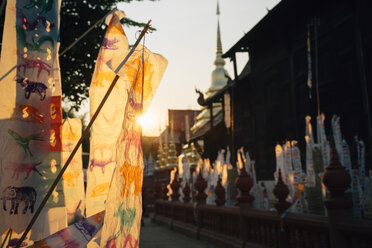Thailand, Chiang Mai, Sunset with decorations to celebrate the New Year at the Wat Phan Tao Buddhist temple - GEMF02266