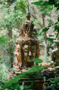 Thailand, Chiang Mai, Buddhist statue in the middle of the jungle in Wat Pha Lat Buddhist temple - GEMF02269