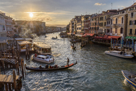 Gondolas moored on a canal lined with historic houses, Venice, Italy. - MINF07484
