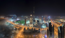 Cityscape of Dubai, United Arab Emirates with illuminated Burj Khalifa and other skyscrapers. - MINF07517