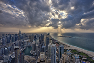 Cityscape of the Dubai, United Arab Emirates under a cloudy sky, with skyscrapers and coastline of the Persian Gulf. - MINF07556
