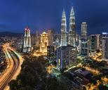 Cityscape of Kuala Lumpur, Malaysia at dusk, with illuminated Petronas Towers. - MINF07592