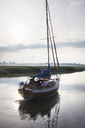 Man on sailboat on river. - MINF07676