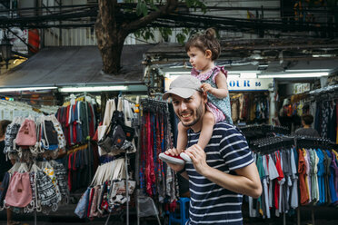Thailand, Bangkok, portrait of smiling father and daughter on Khao San Road - GEMF02282