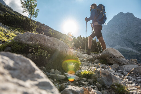 Austria, Tyrol, Young man hiking in the mountains - DIGF04771