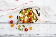 Tortellini salad with tomato, mozzarella and basil in lunch box - LVF07392