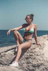 Teenage girl wearing bikini and sunglasses - ACPF00204