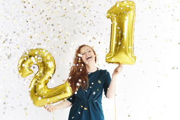 Happy young woman with golden  balloons celebrating her birthday - ABIF00885