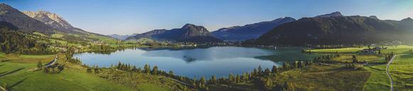 Austria, Tyrol, Kaiserwinkl, Aerial view of lake Walchsee, panorama - AIF00545