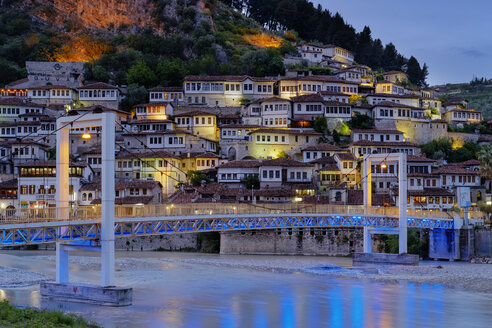 Albania, Berat County, Berat, Mangalem, Ottoman houses and castle rock at blue hour, bridge over Osum river - SIEF07865