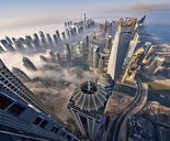 Aerial view of cityscape with skyscrapers above the clouds in Dubai, United Arab Emirates. - MINF08034
