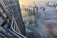 Aerial view of cityscape with skyscrapers above the clouds in Dubai, United Arab Emirates. - MINF08037