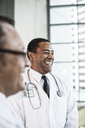 Black man doctor in lab coat with a stethoscope. - MINF08257