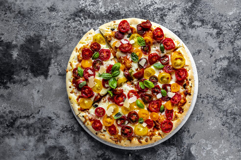 Sliced pizza with tomatoes and basil leaves - SARF03902