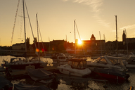 Poland, Szczecin, harbour at sunset - FCF01442