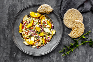 Salad with peaches, feta and mint served with pita bread - SARF03904