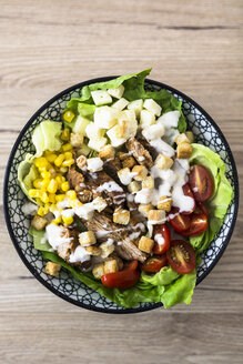 Bowl of Caesar salad with meat, corn and tomatoes - GIOF04126