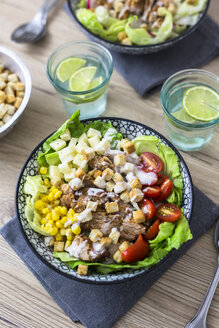 Bowl of Caesar salad with meat, corn and tomatoes - GIOF04129