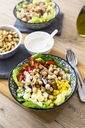 Bowl of Caesar salad with meat, corn and tomatoes - GIOF04132