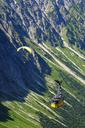Germany, Bavaria, Allgaeu, Allgaeu Alps, Tandem paragliders and Nebelhorn Cable Car - SIE07871