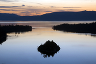 A silhouette of Fannette Island in Emerald Bay at sunrise in Lake Tahoe, CA. - AURF00395