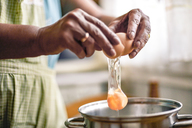 Hands of a woman breaking an egg - ACPF00232