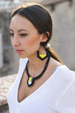 Portrait of young woman wearing modern necklace and earring - AFVF01420