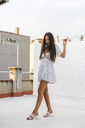Fashionable young woman on roof terrace - AFVF01423