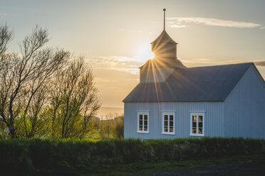 Iceland, Vatnsnes, Hvammstangi, church against the sun - KEBF00883