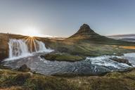 Iceland, Snaefellsnes, Kirkjufell, Kirkjufellsfoss waterfall at sunset - KEBF00886