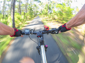 France, Landes, senior man on e-bike in the forest - LAF02073