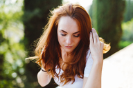 Portrait of redheaded young woman in nature - GIOF04212