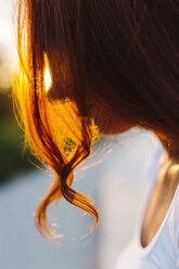 Profile  of redheaded woman at backlight - GIOF04227