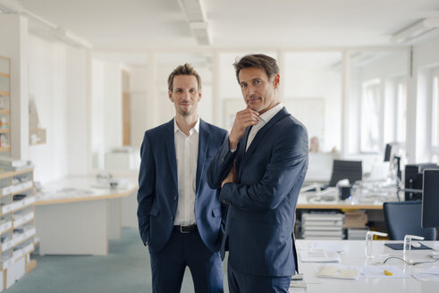Portrait of two successful businessmen in their office - GUSF01199