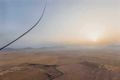 Morocco, view from air balloon at desert and Jbilet mountains by sunrise - MMAF00502