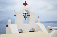 Traditional white bell tower of church on the island of Santorini, Greece. - MINF08644