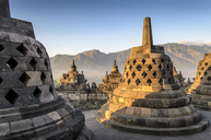 Borobudur temple, a 9th century Buddhist temple with terraces and stupa with latticed exterior, bell temples housing Buddha statues.  UNESCO world heritage site. - MINF08650