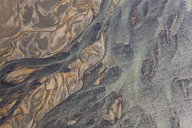 Aerial view of landscape with river coloured by glacial melt. - MINF08808