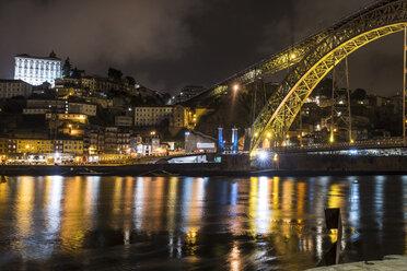 Portugal, Porto, view to the city and Ponte Luiz I Bridge over Douro river at night - CHPF00522