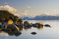 Golden afternoon light illuminates granite boulders on the east shore of Lake Tahoe, NV. - AURF00642